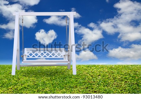 Wood swing chair with beautiful cloud and sky - stock photo