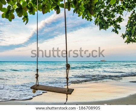 wood swing near sea for relax  - stock photo