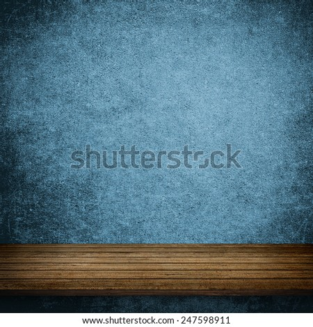Wood table and blue concrete wall background - stock photo