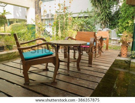 Wood table and chair in the garden