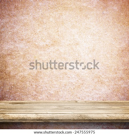 Wood table and colorful concrete wall background - stock photo