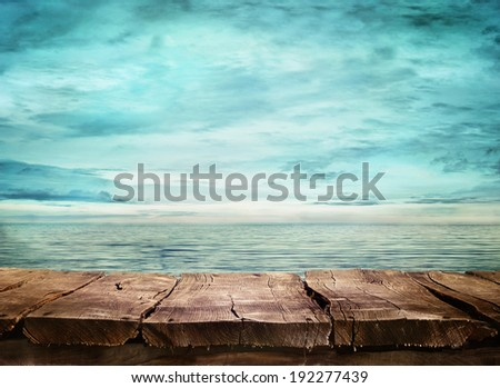 Wood table and tropical landscape in the background.. Spring or summer abstract nature background.  - stock photo