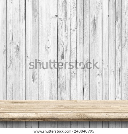 Wood table and white wooden wall background - stock photo