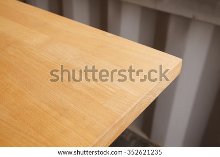 Wood table top on blur background of coffee shop interior. - stock photo