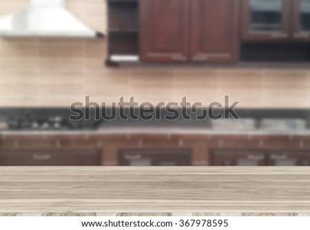Wood table top on blur the background of the kitchen. - can be used for display your products or promotional and advertising posters  - stock photo
