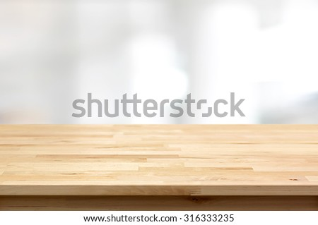 Wood table top on blur white gray abstract background - can be used for display or montage your products - stock photo
