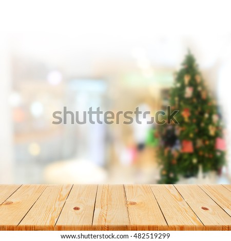 Wood table top on Blurred office decorated Christmas background - can be used for display or montage your products