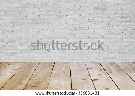 Wood table top on brick wall  background