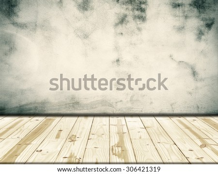 Wood table top on concrete walls background