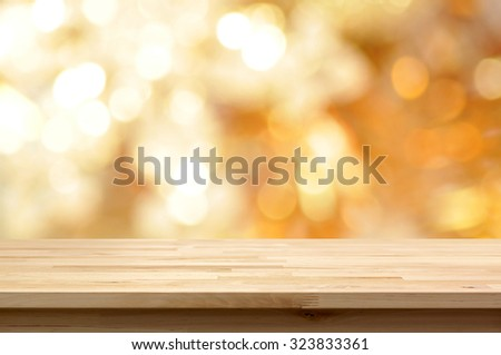 Wood table top on golden bokeh abstract background  - can be used for montage or display your products - stock photo