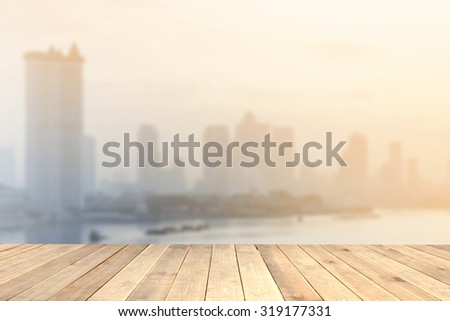 Wood table top with blurred city view as background - can be used for montage or display your products
