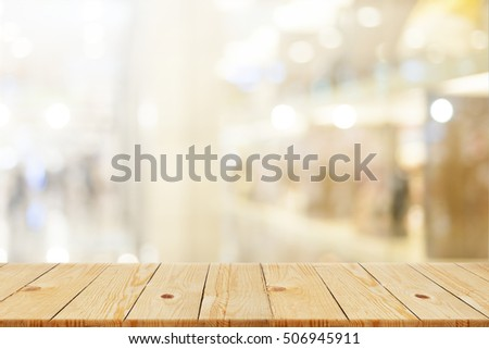 Wood table top with blurred office as background - can be used for montage or display your products