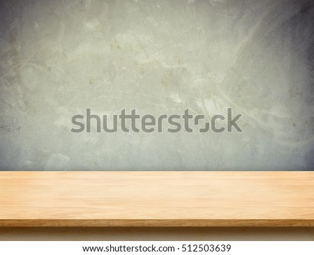 Wood table top with grunge concrete wall,Mock up template for display or montage of product