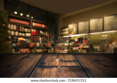 Wood Table With Coffee Shop View In Background - stock photo
