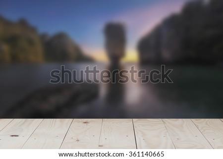 Wood terrace with Blur Sunset James Bond island near Phuket in Thailand. - stock photo