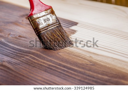 Wood texture and paintbrush, concept of home renovation - stock photo