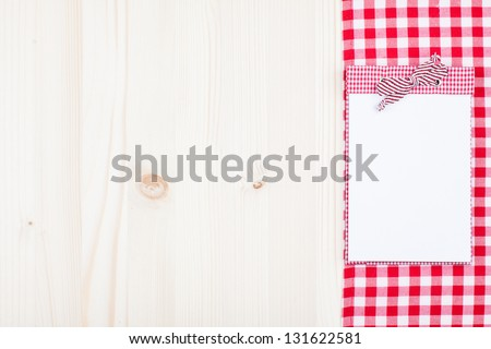 Wood texture background with recipe cookbook, red and white tablecloth - stock photo