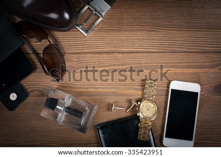 wood texture. Men's everyday objects on a dark background. business meeting. Accessories for the business of the day.