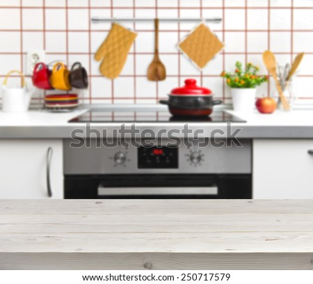 Wood texture table on defocused kitchen bench background - stock photo