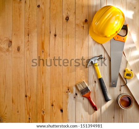 wood texture with construction tools, helmet, paint and brush