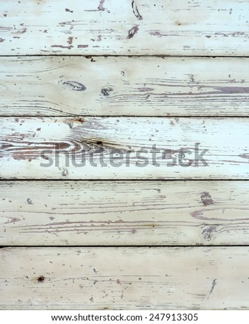 Wood texture with flaked paint - stock photo
