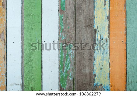 Wood texture with painting color peeled off - stock photo