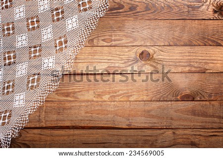 Wood texture, wooden table with white lace tablecloth top view. Collage for menu - stock photo
