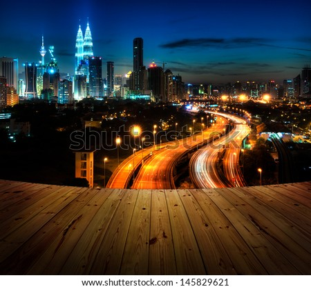 Wood textured backgrounds in a room balcony view. Kuala Lumpur is the capital city of Malaysia. - stock photo