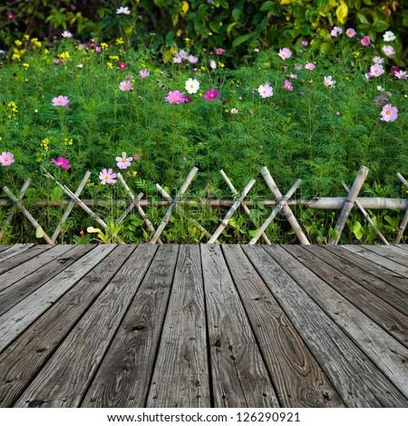 wood textured backgrounds over garden. - stock photo