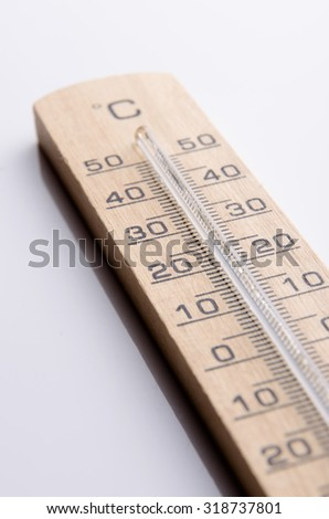 Wood thermometer for measuring the temperature outside. - stock photo