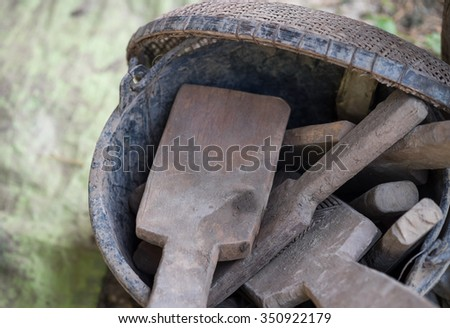 Wood tools in a bucket for shaping clay pot with selective focused point for handicraft background - stock photo