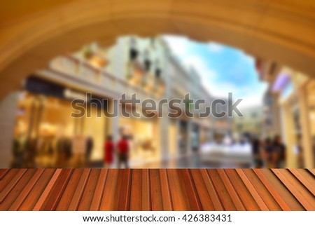 Wood top on blurred imag of super store use for background - stock photo