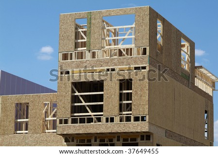Wood townhouse building under construction - stock photo