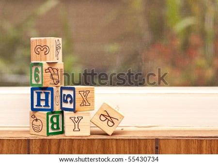 Wood Toy Blocks on Window Sill - stock photo