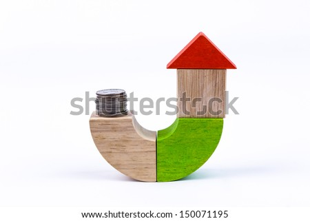 wood toys, start saving for a house - stock photo