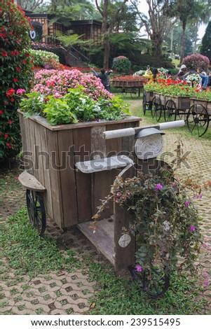 wood  tray, motorcycle concept decoration  in garden of Doi Tung Royal Villa, Chiang Rai, Thailand - stock photo