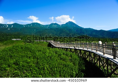 Wood walkway in Five Lake and mountain at Shiretoko, Hokkaido, Japan - stock photo