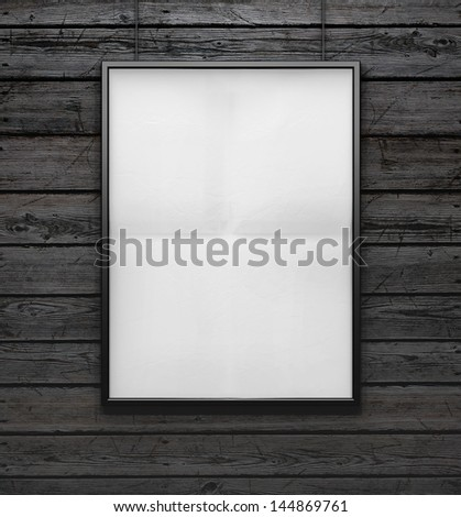 wood wall and blank frame - stock photo