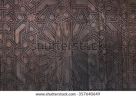 wood wall with Muslim pattern ,islamic pattern wooden engraving, islamic artist style - stock photo