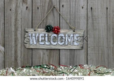 Wood welcome sign with snow garland border
