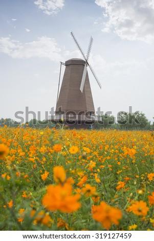 Wood windmill - stock photo