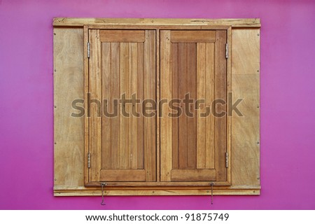 wood window on pink wall