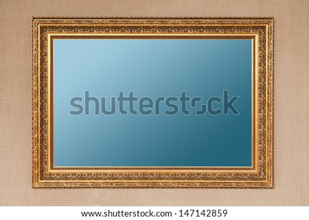 Wood with gilding empty picture frame - stock photo