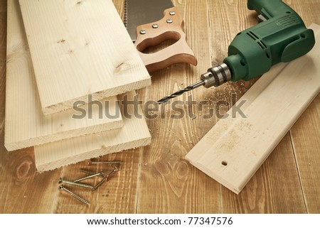 Wood work tools and planks. Including hand saw, drill,screws. - stock photo