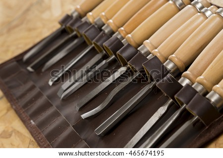 Wood worker's chisel set closeup on a bright background