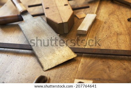 Wood working. Saw, clamps and old wooden boards.  - stock photo