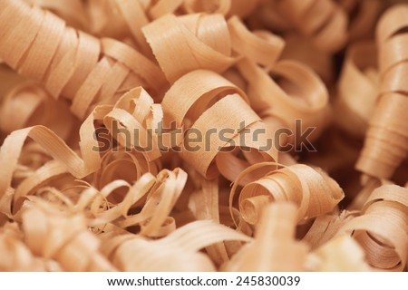 Wood working wood shavings in variety of sizes. - stock photo