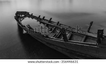 Wood wreck on the beach Black and white color - stock photo