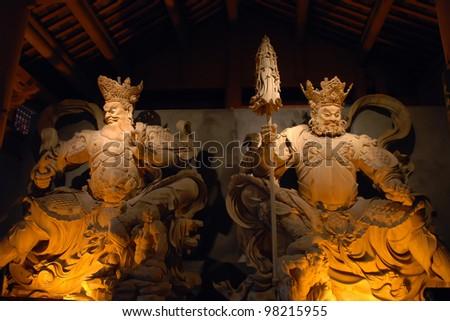 Woodcut Fighting Statue - stock photo
