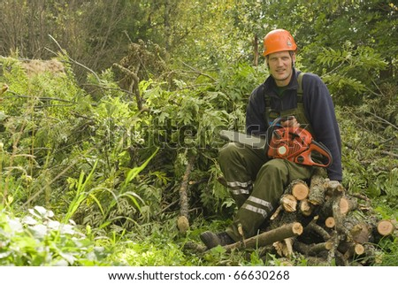 Woodcutter resting from work. - stock photo